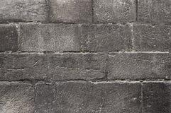 Oude donkere grijze van de steenmuur textuur als achtergrond Royalty-vrije Stock Foto