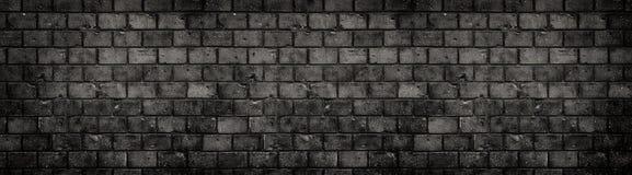 Oude en doorstane grungy zwarte donkergrijze concrete de textuur van de blokbakstenen muur wijd grote panoramische banner als ach royalty-vrije stock foto