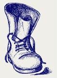 Oude en vuile laarzen Stock Foto's