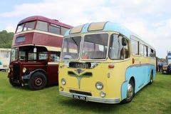 Oude ENGELSE bussen Stock Afbeeldingen