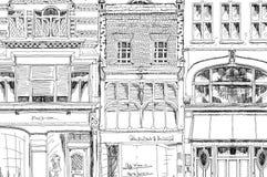 Oude Engelse rijtjeshuizen met kleine winkels of zaken op benedenverdieping Bandstraat, Londen schets Stock Afbeeldingen