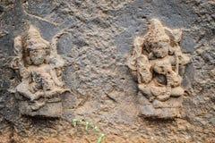 Oude epische god en godinsteengravures in de oude stad van India royalty-vrije stock fotografie