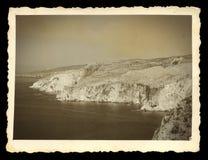 Steile overzeese klippen uitstekende foto Stock Afbeeldingen