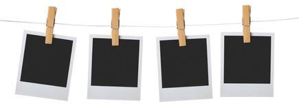 Oude fotoframe palaroid maakt aan kabel vast Stock Foto's