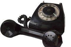 Oude geïsoleerde schijftelefoon Stock Foto's