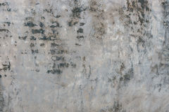 Oude gebarsten grijze concrete muurachtergrond Royalty-vrije Stock Foto