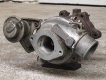 Oude, gebruikte turbocompressor stock foto