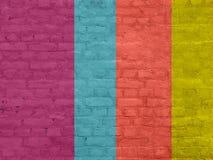 Oude gekleurde bakstenen muur stock afbeelding