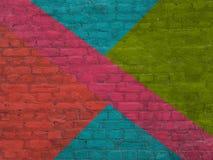 Oude gekleurde bakstenen muur stock foto