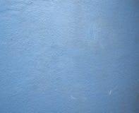 Oude geschilderde blauwe concrete muurachtergrond stock foto