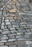 Oude glanzende steenbestrating stock foto's