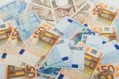 Oude Griekse 1000 drachmenbankbiljetten en euro rekeningen Stock Afbeeldingen