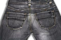 Oude grijze retro jeans, achtermening stock foto
