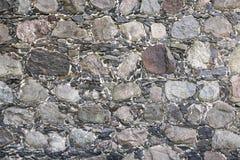 Oude grijze steenmuur, achtergrondtextuur Stock Foto's