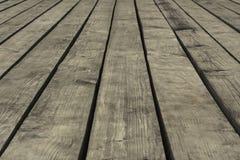 Oude grijze vloerplanken met hiaten, close-up, achtergrond, textuur royalty-vrije stock afbeelding