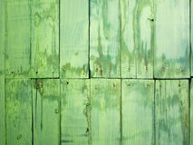 Oude groene geschilderde en bevlekte houten planken met spijkerhoofden Royalty-vrije Stock Foto's