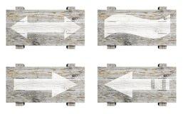 Oude houten die tekens met pijlen worden geplaatst Stock Foto
