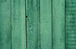 Oude houten groene geschilderde omheining, mooie achtergrond Royalty-vrije Stock Foto