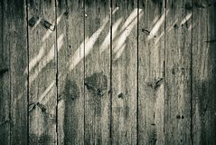 Oude houten omheining met lichte vlekkenachtergrond Royalty-vrije Stock Fotografie