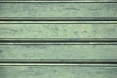 Oude houten oppervlakte van de strak genagelde planken met barsten en exfoliating verf Groene Achtergrond royalty-vrije stock fotografie