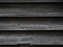 Oude houten textuur als achtergrond op een huis royalty-vrije stock afbeeldingen