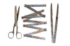 Oude hulpmiddelen op een witte achtergrond Stock Afbeeldingen