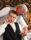 Oude kapper en klant Royalty-vrije Stock Foto