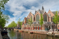 Oude Kerk, Amsterdam, Holland. Oude Kerk over canal at spring day, Amsterdam, Holland Royalty Free Stock Photos