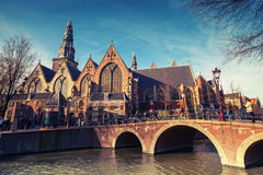 Oude Kerk. Old church on the canal coast in Amsterdam Royalty Free Stock Photography