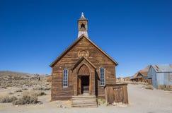 Oude kerk in verlaten spookstadlichaam Stock Afbeelding