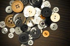 Oude kledingsknopen Stock Foto
