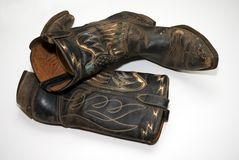 Oude laarzen op vloer Stock Fotografie