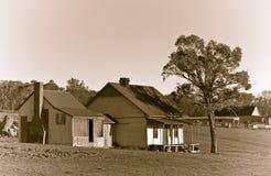 Oude landbouwbedrijfboerderij in sepia Royalty-vrije Stock Afbeeldingen