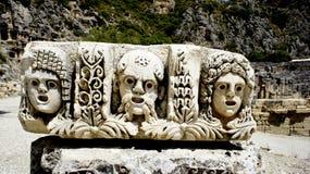 Oude lycianstenen met drie gezichten Stock Foto's