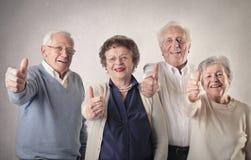 Oude mannen en vrouwen Stock Foto's