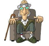 Oude mens in een leunstoel Royalty-vrije Stock Fotografie