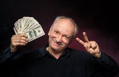 Oude mens met dollarrekeningen Stock Afbeeldingen