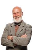 Oude mens met een grote baard en een glimlach Stock Foto's