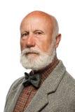 Oude mens met een grote baard en een glimlach Stock Foto