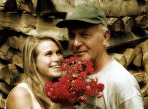 Oude mens met een jonge dame Royalty-vrije Stock Fotografie