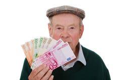 Oude mens met geld Stock Fotografie
