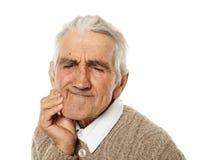 Oude mens met tandpijn Stock Fotografie
