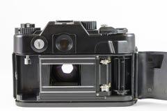 Oude 35mm SLR camera met open rugdekking Royalty-vrije Stock Afbeeldingen