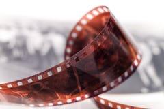 Oude 35 mm verdraaide film Royalty-vrije Stock Afbeeldingen