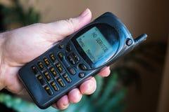 Oude mobiele telefoon met Royalty-vrije Stock Foto's