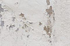 Oude muur met schilpleister stock afbeelding