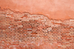 Oude muurbaksteen en gipspleister Stock Foto