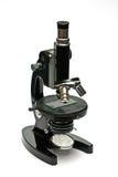 Oude optische geïsoleerdeg microscoop Royalty-vrije Stock Foto's