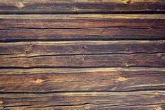 Oude oude uitstekende blauwe gele houten houten de muurachtergrond van het logboekenhout Stock Foto