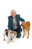Oude oude vrouw met huisdieren Stock Foto